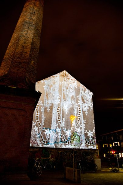 Pieces of lace projected on the gable outside Brandts Klædefabrik.
